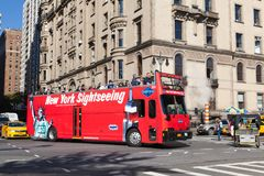 NEW YORK, USA - OCTOBER 15, 2013: Red tourist bus HOP ON HOP OFF BUS TOURS in a Central Park West in Midtown NYC stock photography