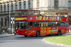 Hop on Hop Off Guided City Tour Bus. Hop On Hop Off guided tour bus operating in many famous tourist cities Royalty Free Stock Image
