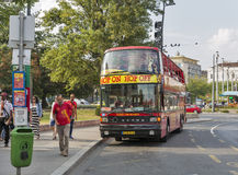 Hop on hop off touristic bus boarding in Budapest, Hungary. Royalty Free Stock Photo