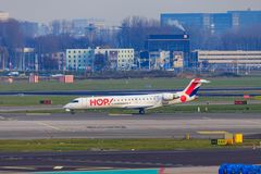 Hop! jet taxiing at Amsterdam. Bombardier CRJ 700 of Hop!, the regional airline of Air France, taxiing at Amsterdam Airport Schiphol stock photos