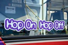 Hop On Hop Off tour bus, Malta. Maltese sightseeing bus window and sign, Marsaxlokk, Malta, Europe Stock Images