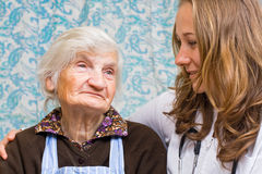 Hope. Old woman tells a story to the young doctor Royalty Free Stock Image