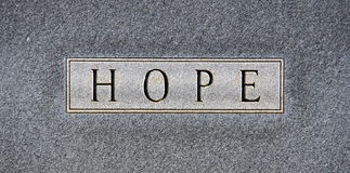 Hope. The word HOPE in all capital words chiseled on a gray granite headstone Stock Photography