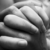 Hope. A couple holding hands close up Royalty Free Stock Image