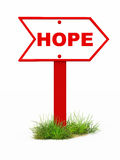 Hope. Arrow on a direction board pointing towards hope, on a patch of grass, board in red color Royalty Free Stock Photo