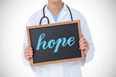 Hope against doctor showing little blackboard Royalty Free Stock Photos