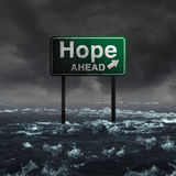 Hope Ahead. Inspirational and motivational life concept as a highway sign drowning in deep flood waters after a hurricane storm as a message of spiritual faith Stock Images