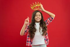Hope for the best. Kid hold golden crown symbol of princess. Childhood concept. Every girl dreaming to become princess. Girl cute baby hold crown while stand stock photo
