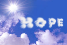 Hope. Clouds against a blue sky with sun rays Stock Images