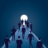 Hope Concept. Business People Walks Forward To Bright Light Stock Photo