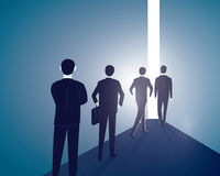 Hope Concept. Business People Walks Forward To Bright Light Stock Images