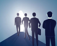 Hope Concept. Business People Walks Forward To Bright Light Royalty Free Stock Image