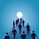 Hope Concept. Business People Walks Forward To Bright Light Royalty Free Stock Photo