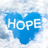 Hope concept tell by shy cloud nature. Sky cloud hope concept word inside heart shape royalty free stock photography