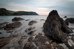 Hope Cove sunset landscape seascape with rocky coastline and lon Stock Images