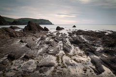 Hope Cove sunset landscape seascape with rocky coastline and lon Stock Photo