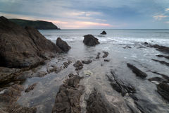 Hope Cove sunset landscape seascape with rocky coastline and lon Royalty Free Stock Image