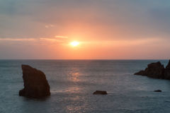 Hope Cove sunset landscape seascape with rocky coastline and lon Stock Photos