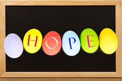HOPE on Eggs colorful on chalkboard with copy space. royalty free stock photo