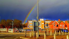 Hope in England. A rainbow coming out after many rainy days in Newbury, United Kingdom, being in perfect harmony with the color of the houses and the sky. The Stock Photography