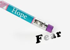 Hope erase fear. Concept of hope erasing the idea of fear using an eraser analogy Stock Photography