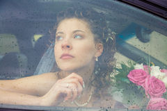 Hope for the future. View of beautiful woman sitting in the car driving her to wedding Stock Image