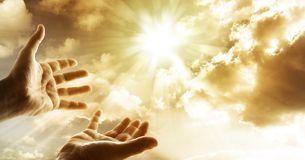 Hope. Hands reaching for the sky Royalty Free Stock Images