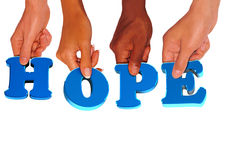 Hope holding. Each hand holding a letter hope Royalty Free Stock Photos