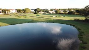 Paradise Point Gold Coast Hope Island Golf Course water trap sunrise stock video footage