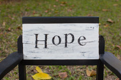 Hope letter on the vintage chair Stock Photos