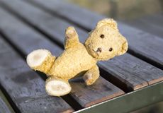 Hope, love concept - toy bear giving paw. Hope, love concept - toy bear lying on the board and giving paw stock photo