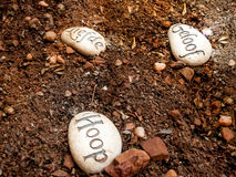 Hope Love and Faith message on stones placed on ground Royalty Free Stock Photo