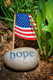 Hope message, stone and USA flag. Hope message, carved on stone with USA flag Stock Image