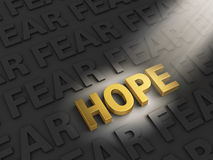 Hope Outshines Fear. A spotlight illuminates a bright, gold HOPE on a dark background with rows of FEAR vector illustration