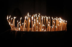 Hope and peace with burning candles in a church Royalty Free Stock Image