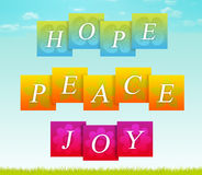 Hope, Peace, Joy. Sign for hope, peace, and joy with sky and grass background Stock Image