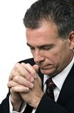 Hope in Prayer. Man with hands folded and head bowed in a posture of prayer Stock Image