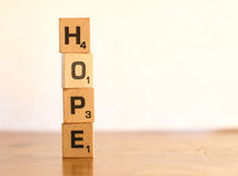 Hope. Scrabble letters spelling hope vertically Stock Photos