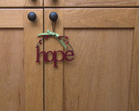 A metal hope sign around the holidays hangs. A hope sign around the holidays Royalty Free Stock Photo