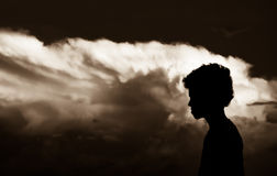 Hope. A silhouetted boy with cloudy backgroud Royalty Free Stock Image