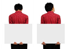 Hope something. Mans holding a big blank card on his back with two different choice of pose stock photos