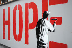 Hope street art piece. A street art piece in Oslo, Norway depicting a man painting the word 'hope' on a wall Royalty Free Stock Images
