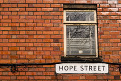 Hope Street. The Hope Street sign on brick wall Stock Photos