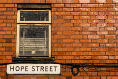 Hope Street. The Hope Street sign on brick wall Royalty Free Stock Images