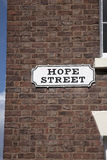 Hope Street Sign on Red Brick Wall, Liverpool Stock Images