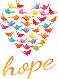Hope text beneath a heart filled with origami paper cranes Stock Images