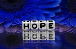 Hope text with blue flowers Stock Photo