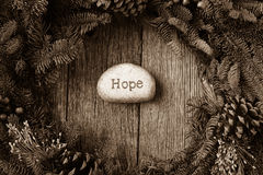 Hope in Text on a Christmas Wreath. Hope in Text in the center of a Christmas Wreath stock image