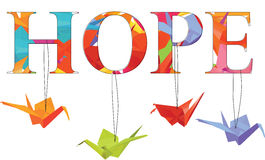 Hope text with colorful origami paper cranes Royalty Free Stock Photography