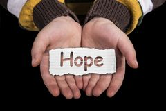 Hope text on hand Stock Image